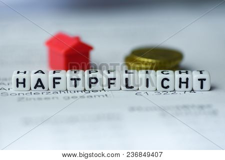 German Word Liability Formed By Alphabet Blocks: Haftpflicht Real Estate Business