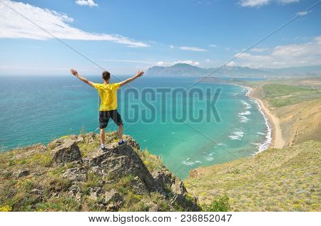 Man and sea mountain landscape. Conceptual and emotional scene.