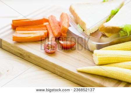 Healthy Lunch Concept. Lunch Box Food Assortment: Sandwiches, Baby Corns, Cherry Tomatoes, Carrots O