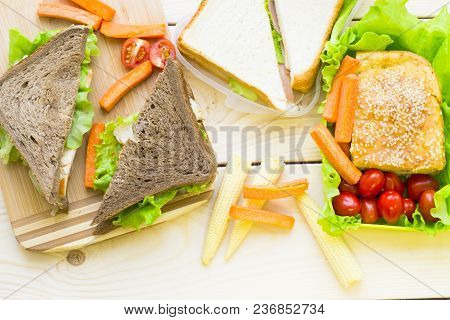 Healthy Lunch Concept. Lunch Box Food Assortment: Rye And Wheat Bread Sandwich And Vegetables, Light