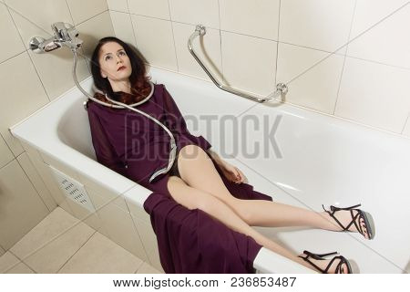 Lifeless Beautiful Woman Lies In A Bathtub