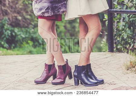 Two Unrecognizable Fashionable Women Wearing Stylish Shoes Outdoor. Boots Perfect For Autumn And Win