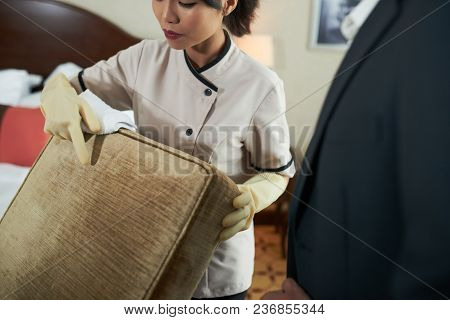 Maid Showing Staid On Pillow To Hotel Manager