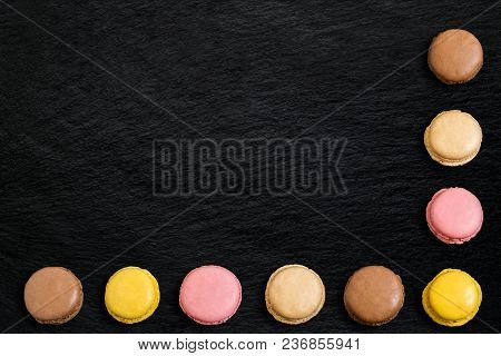 Different Macaroon On Slate Background. Delicious And Sweet Almond Cookies Macaroon With Cream, Fren