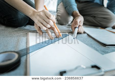 Every Millimeter Important. Close Up Of Female Attractive Hands Holding Pencil For Creating Graphic