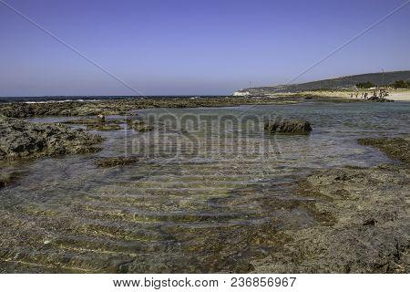 Rocky Beach At Low Tide. Mediterranean Sea. Seacape