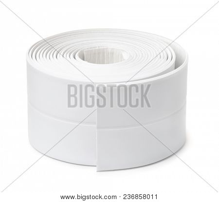 Roll of white adhesive flexible caulk strip isolated on white