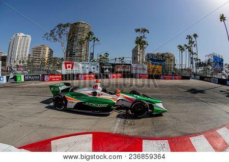 April 13, 2018 - Long Beach, California, USA: Kyle Kaiser (32) brings his race car through the turns during the Toyota Grand Prix of Long Beach race in Long Beach, California.
