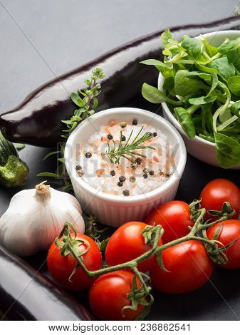 Mix Of Raw Vegetables With Salt, Spices On Dark Background. Clean Healthy Eating Concept