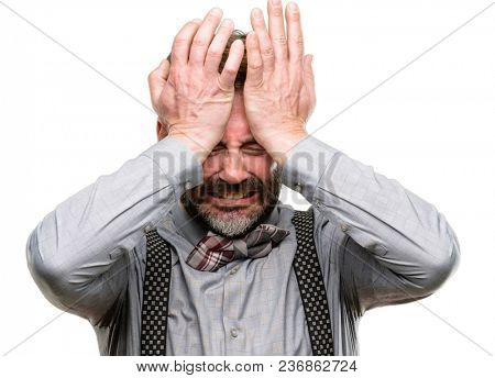 Middle age man, with beard and bow tie terrified and nervous expressing anxiety and panic gesture, overwhelmed isolated over white background