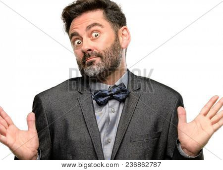 Middle age man, with beard and bow tie doubt expression, confuse and wonder concept, uncertain future isolated over white background