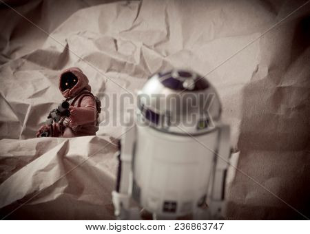 APR 17 2018: Recreation of a scene from Star Wars A New Hope; Jawa scavengers of the desert planet Tattooine capture astromech droid R2D2 - Hasbro Black Series action figures