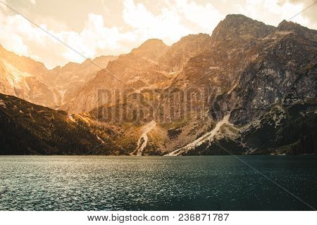 Panorama Of The Beautiful Blue Lake In The Mountains At Sunset, Tatra Poland