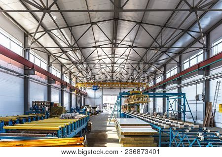 Sandwich Manufactory Panel Production Line. Equipment Machine Tools And Roller Conveyor In Large Han