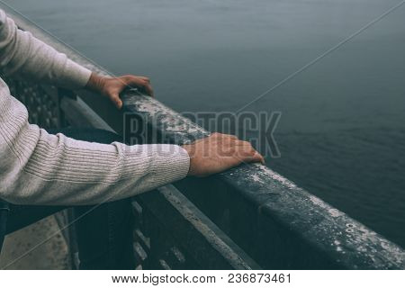 Depressed Man Is Going To Jump From Bridge, Close Up View On Hands. Suicide Concept.