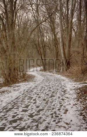 Grist Mill Trail With Snow And Footprints