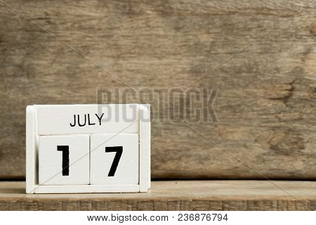 White Block Calendar Present Date 17 And Month July On Wood Background