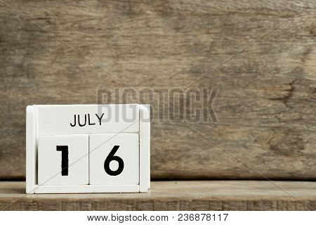 White Block Calendar Present Date 16 And Month July On Wood Background