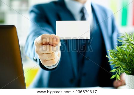 Male Arm In Suit Give Blank Calling Card To Visitor Closeup. White Collar Colleagues Company Name Ex
