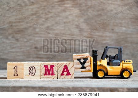 Toy Forklift Hold Block Y To Complete Word 19 May On Wood Background (concept For Calendar Date For