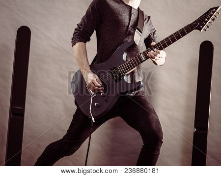 Unrecognizable Male Person With Electric Guitar. Close Up, Part Body Guy Is Holding Instrument And P