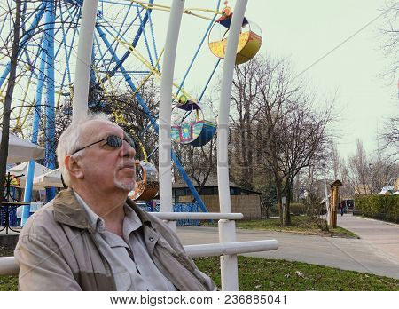 An Elderly Man In A Spring Park Remembers