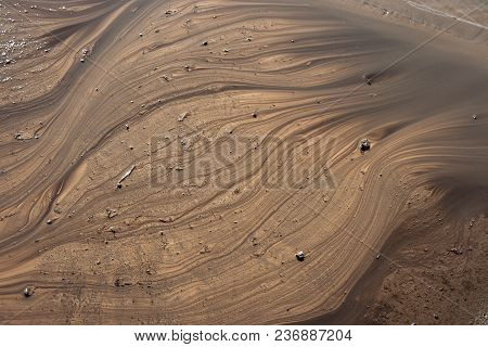 Abstract Background Of The Line For Water On The Brown Earth