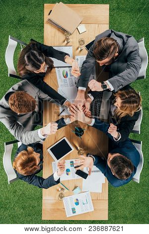 Top View Of Business Partners At Table In Office, Businesspeople Teamwork Collaboration Relation Con