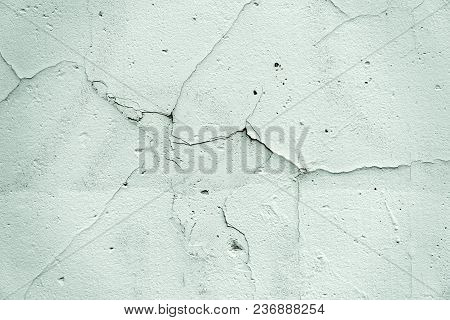 Cracked Facade Wall Surface As Texture Or Background
