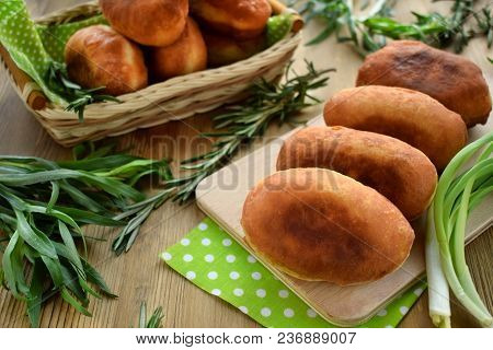 Golden Fried Patties On A Wooden Board Surrounded By Green Onion And Tarragon. Russian Cuisine Meal