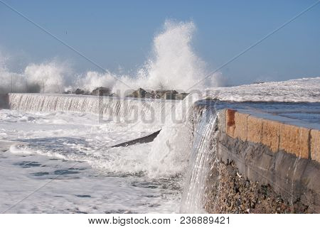 View Of Pier Under A Big Wave Of Camogli