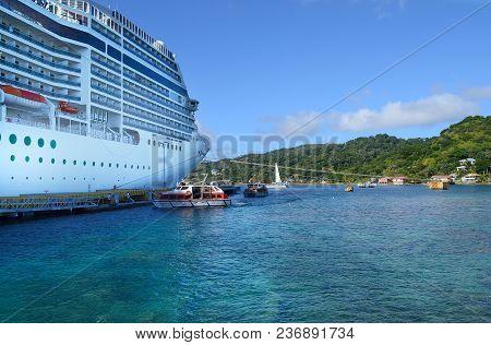 Coxen Hole, Roatan, Honduras - Dec 26 2012: The Cruise Ship Msc Poesia Lays At Anchor At The Port Of