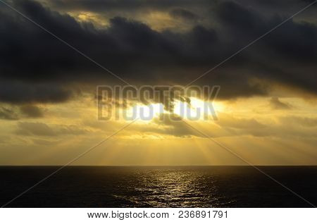 Beautiful Sunset Over The Caribbean Sea With Golden Sun Streaks And Reflections On The Water.