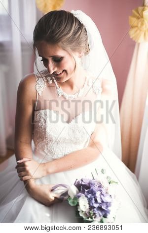 Gorgeous Bride In Robe Posing And Preparing For The Wedding Ceremony Face In A Room.