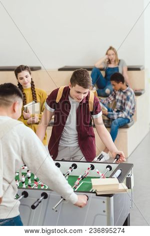 High School Students Playing Table Football At School
