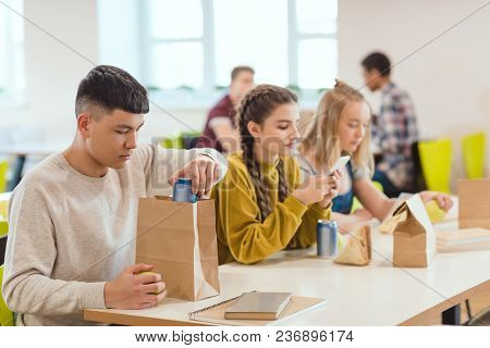 Teenage High School Students At School Cafeteria During Lunch