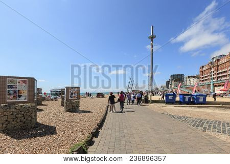 Brighton, United Kingdom - August 1, 2017: Tourists Admire The Amazing View Of English Channel And T