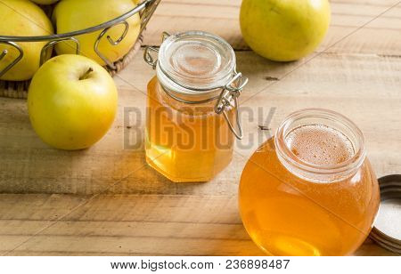 Home Made Apple Jelly Jars And  Granny Smith Apples On Wooden Table