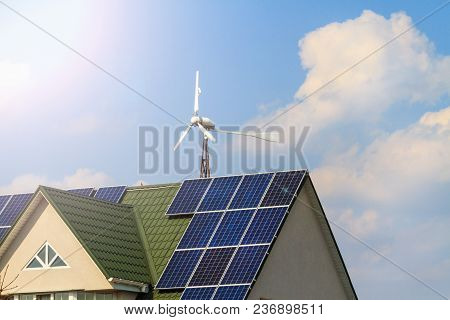 Building That Uses Solar Panels And A Windmill With Sunny Hotspot, New Technologies, Optimization Of