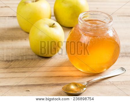 Apple Jelly Jar And Spoon With Granny Smith Apples On Wooden Table