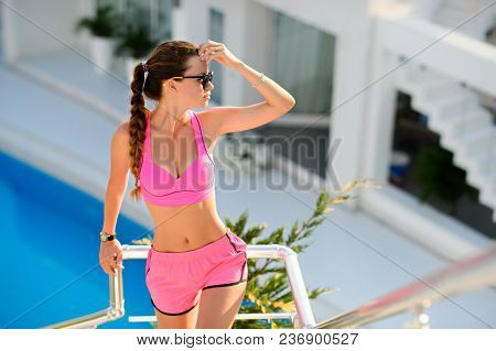 Sexy Girl With Long Hair In A Swimsuit Posing Outdoors