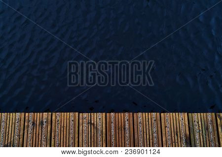 Wood Pier With Water On Side Background Top View