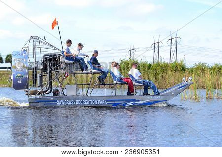 Weston, Florida - December 27, 2012:  Tourists On An Airboat At Sawgrass Recreation Park In The Flor