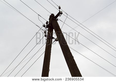 Electric Pole Of A High Voltage Power Line With Wires On A Sky Background.