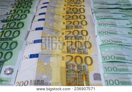 Scattered 200 Euro, 100 Euro, Banknotes, European Currency - Background.