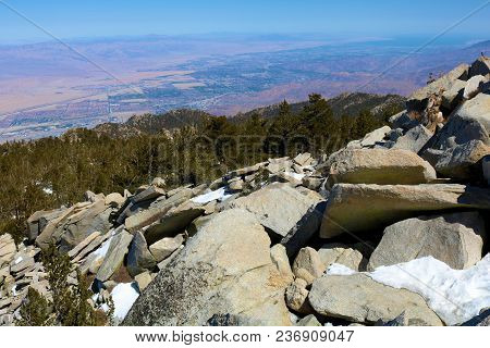 Rugged Rocky Terrain Overlooking The Desert Including Palm Springs Taken From Mt San Jacinto Peak, C