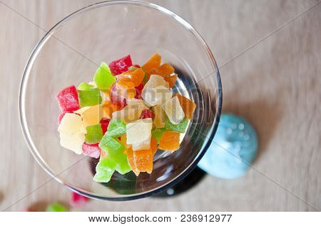 Martini Glass Filled With Colorful Candy Of Candied Fruit, Top View