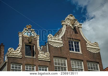 Close-up Of Brick House Facade Decoration At Begijnhof, A Medieval Semi-monastic Community In Amster
