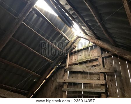 The Old Ruined Abandoned Loft With A Door, The Roof From The Inside With The Slate Of The Sun, Makin