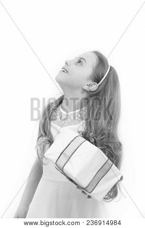Girl Look Up With Long Blond Hair Isolated On White. Happy Child Hold Box With Red Bow. Boxing Day C